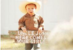 A fun twist for your ring bearer; have him carry a sign announcing the bride! Great for a country wedding.