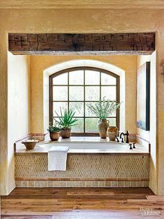 Introduce old-world design ideas to encourage lingering in your rustic bathrom. Venetian-plaster walls and a substantial beam take their cues from… Decor, Mediterranean Bathroom, Marble Design, Bathroom Styling, Bath Design, Mediterranean Baths, Beige Bathroom, Rustic Bathrooms, Bathroom Design