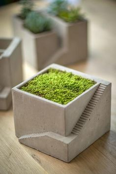 """Simple yet intriguing cement planter features a staircase design, reminiscent of a creation by M.C. Escher. (Plant not included.) Dimensions: 6.75""""square x 5.25""""h."""