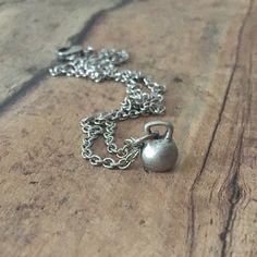 THE perfect Kettlebell necklace is powerful yet understated. The Kettlebell charm is crafted from solid pewter or bronze and is amazing all by itself. Visit us at www.afflatusdesigns.com for more strength and fitness jewelry. Sign up for our newsletter and receive 10% off!