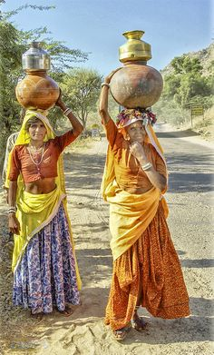 """Of the total burden of paid and unpaid work women bear an average of in developing countries and in industrial countries. ""major portion of the time of rural area women is spent in collecting water from different sources. Amazing India, Indian People, India Culture, Indian Art Paintings, Rajasthan India, India India, India Art, World Photography, Up Girl"