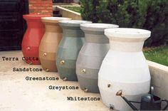 Rain barrels - assorted colors to blend in or stand out, as desired Rain Barrels, River Stones, Rain Garden, Backyard, Patio, How To Buy Land, Orange Flowers, Surrey, Outdoor Ideas