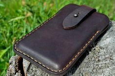 Case for iPhone 7 or iPhone 6 made of excellent harness saddle leather. Thickness is about 2.5 mm (5 oz). Case can be worn on a belt. Stud closure allows easy and quick access and was widely used by the Swiss Army on their unbreakable and famous leather bags! Stitched with two needles method (same as Swiss Army) by hand with waxed thread, 1 mm thick. Impregnated with natural castor and linseed oil. Case holds its shape even when it is empty. All the rivets on the inside covered with leather…