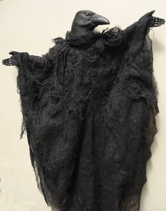 Crow Puppet - I don't know about you, but I think this would make a great costume.