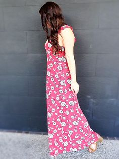 Red floral forever21 maxi dress, boohoo fringe bucket bag, & target lace-up sandals outfit
