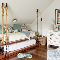 Nautical inspired bed hanging from manila rope, eye spliced and bolted to rafters