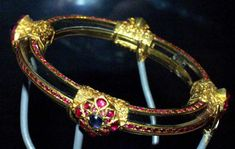 "Bracelet, probably 1500-1600 - The inventory of Elizabeth I's jewels in 1587 describes a rock crystal bracelet, set with ""sparcks of rubies, and little sparcks of saphiers."" This bracelet, which may be the one described, is an outstandingly rare object today. No other Indian bracelets like it have survived from that period. IMAGE: Elizabethan Bracelet at the V&A Museum."