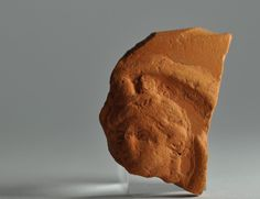 African red slip ware sherd with head 10