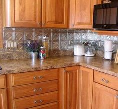 temporary backsplash got questions get answers home stuff pinterest wood cabinets cabinets and wood countertops - Kitchen Metal Backsplash