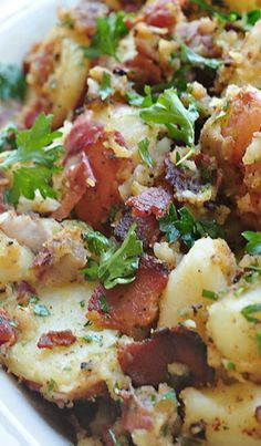 German Potato Salad Recipe, really great, however I chopped a large onion up and sauted while cooking bacon, and added 3 T of dijon mustard instead of 1. yummy.