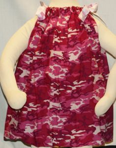 A cute little bandana dress with ribbon shoulder ties.  Fits sizes 2T-4T. Length 20""
