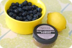 Liquorice Powder, blueberries and yellow lemon.