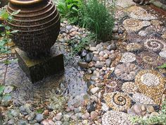 Garden feature path of abstract snails created in pebble by Olicana Mosaics.