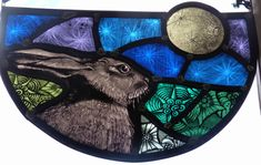 Hare and moon designed and created by Sarah Roberts Stained Glass.