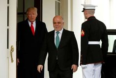 U.S. President Donald Trump greets Iraqi Prime Minister Haider al-Abadi at the White House in Washington, U.S., March 20, 2017.