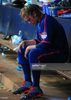 Noah Syndergaard #34 of the New York Mets sits in the dugout after being removed from the game after the fourth inning against the Atlanta Braves at Turner Field on June 20, 2015 in Atlanta, Georgia.