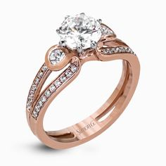 This classic rose gold engagement ring and wedding band set is accentuated by .16 ctw of round cut white diamonds complemented with .14 ctw side stones.