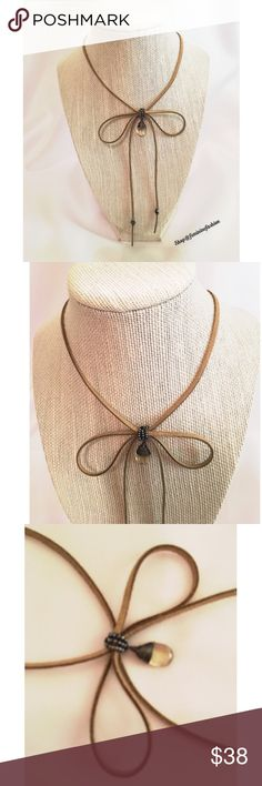 "Nakamol Tan Leather Bow Necklace Nakamol golden tan leather necklace with light topaz colored Pendant. Lobster claw closure. 7"" Drop to bow. 3"" Extender. Thank you for shopping @femininefashion🎀 Nakamol Jewelry Necklaces"