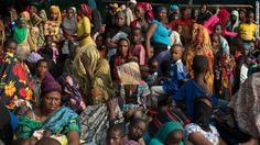People wait for evacuation flights in a hangar at the airport in Bangui, Central African Republic, on Sunday, December 29. The African natio...