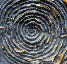 The piece has been cut in a spiral following the swen line revealing the yellow scraps beneath