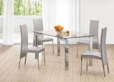 """Argent Dining Chair By Zuomod (Set Of 4) by Zuo Modern. $725.00. At a reasonable 179 a pop you can't go wrong. Classy and Elegant is the best was to define this Dining Chair. From Royalty to majestic. it will impress your Highness as well as your unwelcomed guests. nMade of a silver colored Leatherette with Chrome frame. Priced in sets of (4) only. Dimensions: 17.5""""W x 17.5""""D x 21""""H"""
