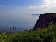 From Ballycastle near an old fort across to Rathlin Island with Fair Head in the background - Northern Ireland
