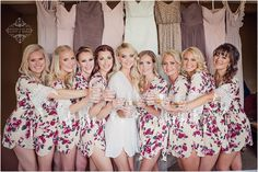 cute bridesmaids photo with dresses in the background