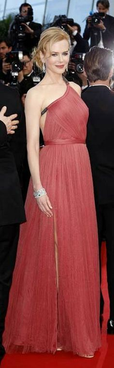 Deep pink goddess-style gown with a gunmetal chain for a one-shoulder strap. The back the dress was backless. Worn by Nicole Kidman at the 2012 Cannes Film Festival