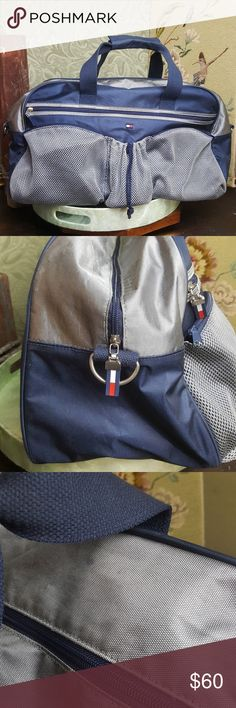 Tommy Hilfiger Sports Duffle Travel Bag VGUC This is a really nice sized Tommy Hilfiger duffle bag. Would be a really great bag if you had sports events. Could be used as a school bag that has to carry around a lot of books or it looks stylish when heading out to workout, it could fit a couple pairs of shoes as well for the traveling sneakerhead! Lots of room. Looks very stylish pointed to a couple spots I have not attempted to washout... might easily wash out. Overall VGUC. Tommy Hilfiger…