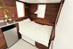 150 sq ft tiny house with a dining space that converts into a double bed.