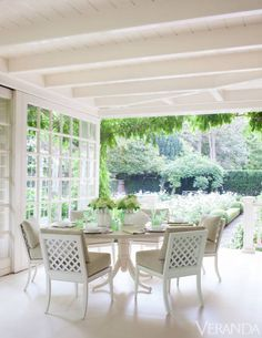 """When the house finally became available, she and her husband snapped it up. """"She's a modern person,"""" Pheasant says, """"but she loves the romance of tradition."""" A terrace overlooks the rose garden. Table and chairs, McKinnon & Harris; cushions in DeLany & Long fabric."""