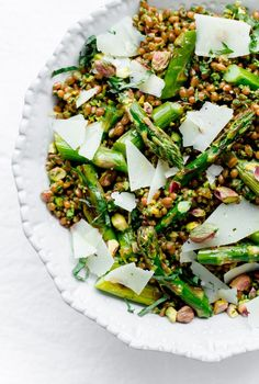 Roasted asparagus wheat berry salad with arugula pistachio pesto, basil, and shaved Manchego! A healthy and hearty springtime vegetarian main course salad. // @ABeautifulPlate