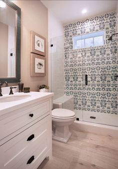 love the tile, white washed floor, simple vanity (minus the outlet so close to the sink)