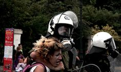 Protests in Athens, Greece, where riot police appear to be using a woman as a human shield