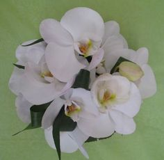 a delicate posy of white phalanopsis orchids by Matthew Spriggs