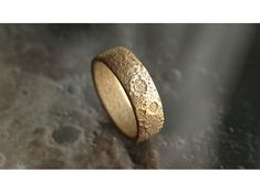The Moon Ring is a topographically correct slice of Moon. Made with planetary data from a Lunar Reconnaissance Orbiter LOLA available in all sizes 3D printed on demand in Stainless Steel, with multiple finishings. via @Shapeways