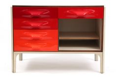 Raymond Loewy for Doubinsky Freres 2000 chest of drawers circa mid 1960′s. This example has the iconic orange and red pop drawer fronts, sliding top with interior storage and rosewood trim.