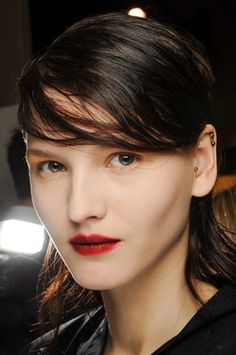 Tom Pecheux's beauty look at Marni's Fall show. We love the all-round matte finish on the skin and lips. We also love the blurring of the lip line.