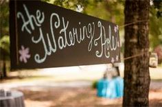 Large Chalkboard  - Rustic Sign - The Watering Hole Rental Price = $6 This chalkboard is best when ties between 2 trees or posts.