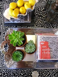 Love the idea of adding a few potted succulents to the tray on our ottoman!