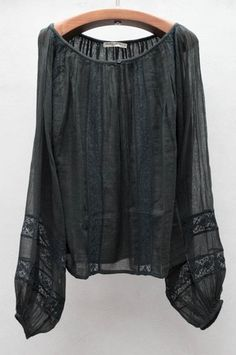 "The ""boho"" feel of this top would be perfectly paired with slim black pants and a simple black boot so that the boho look is there but not overpowering."