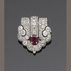 An art deco ruby and diamond clip brooch, by Cartier, circa 1925