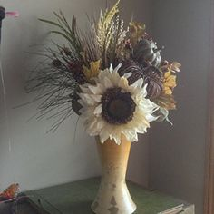 "Fall Silk Flower Arrangement. Fall flowers in neutral colors of creams and greens. This premium arrangement includes an extra large sunflower, pumpkins, fruit, grasses and berries. Truly a one of a kind arrangement. Comes in large and medium sizes, both shown in the last photo. This listing is for the large arrangement which measures 23"" tall."