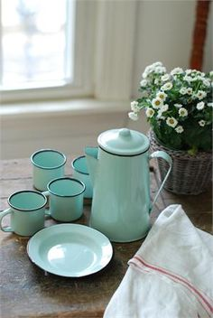 "This nine piece Enamelware Petite Serving Set in Robin's Egg Blue has tons of vintage charm. Reminiscent of a 1940s-style camp set, this sweet enamelware collection includes a coffee pot, four small plates and four small cups. The compact size makes this set perfect for tailgating and picnics or for display in any farmhouse kitchen. Food Safe. Pot: 6""H x 4""Diam and holds 32oz, Plate: 5.5""Diam. Cup: 3.5""H x 2.5""Diam and holds 4oz."