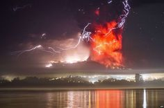 This view from Puerto Varas, southern Chile, shows a high column of ash and lava spewing from the Calbuco volcano, 23 April 2015.