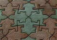 Frogrock™ $85 for a mold, .66 square feet. Also Escher geckos and hexacons