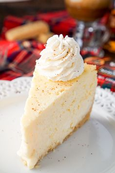 I loved this Eggnog Cheesecake! It's made with a sweet shortbread cookie crust instead of traditional graham crackers and is laced with whisky and nutmeg! I love how festive it is with a unique touch to impress guests! #sp