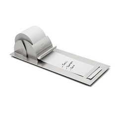Notepaper Roller: This contemporary memo pad dispenses note paper of any length from a replaceable roll. | Uncommongoods.com