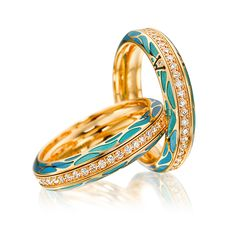 Cellini Jewelers 'Genuine Delight, Aqua' Ring by Wellendorff 'Genuine Delight, Aqua' spinning band ring in aqua blue cold enamel, with a central row of diamonds; Handcrafted in 18-karat yellow gold; interior is engraved with your personal winged guardian angel.
