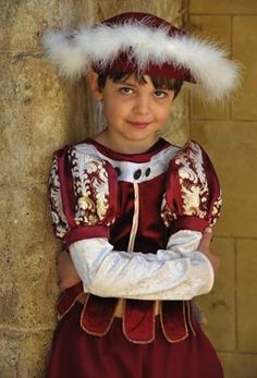 Tudor Boy by Travis Designs - Childrens Fancy Dress, A red and gold majestic Tudor outfit including pantaloons, tunic and a feathered hat.